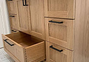 Vanity with custom dovetail drawers and logo engraving
