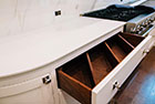 Custom dovetail drawer dividers angled for optimum space